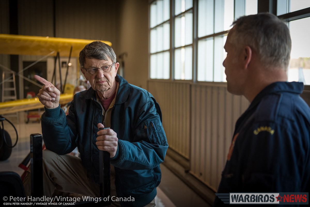 John Aitken (l) and Paul Kissman (r) in discussion back in the Vintage Wings hangar after the flight. (photo by Peter Handley)