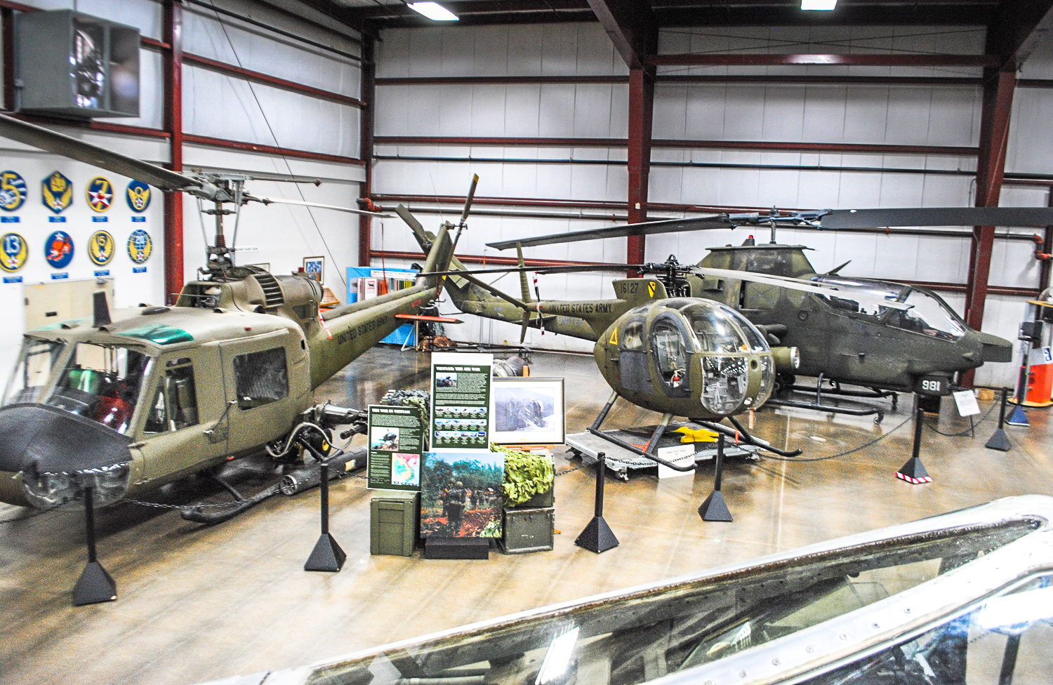 Some of the primary military helicopters involved in the Viet Nam War arrayed for the museum's latest exhibit honoring US service personnel and the US 50th anniversary commemoration of the Vietnam War. (photo via NEAM)