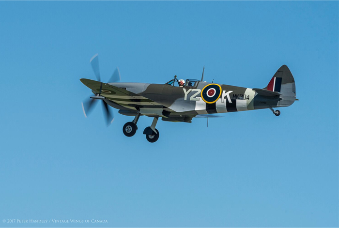 A great shot of the Roseland Spitfire as she climbs back into the sky. The first flight would be carried out a low speed with the landing gear extended throughout. Photo: Peter Handley, Vintage Wings of Canada
