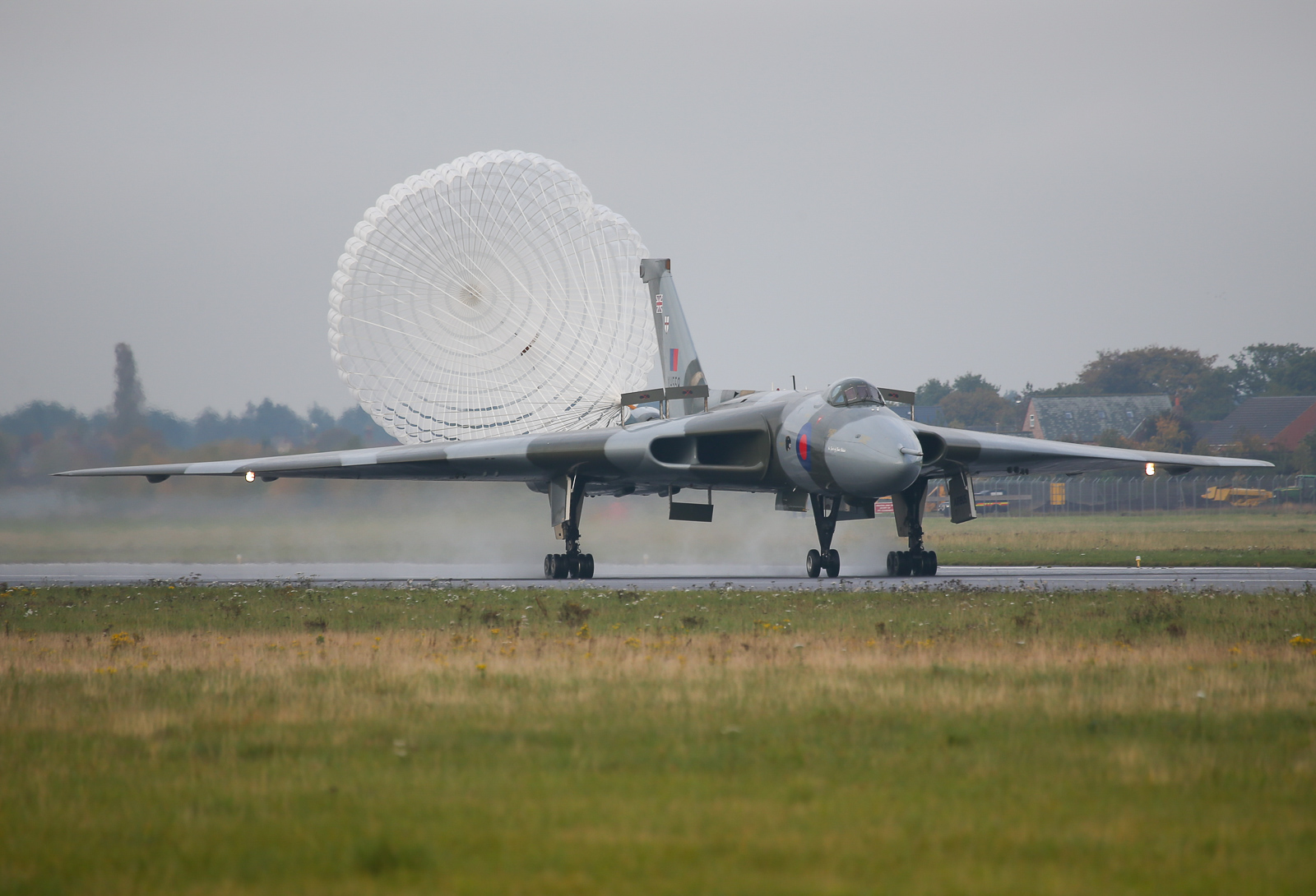 XH558 on rollout with her parachute deployed. Enthusiasts should at least get to see this sight in the future during high speed taxi runs, though never after a flight again. (photo by Steven Comber)