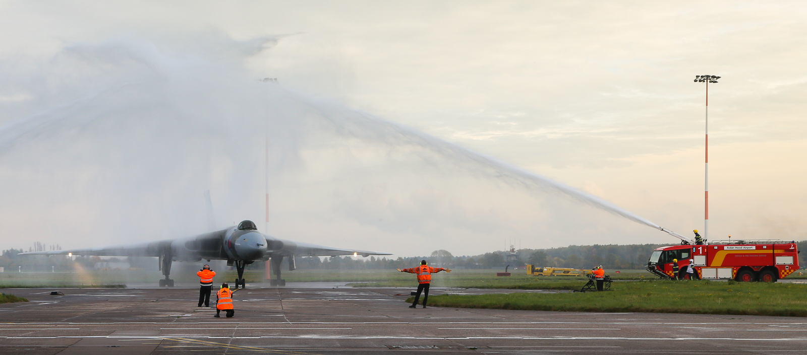 XH558 receives a final water-cannon salute as she taxies in after her final flight. (photo by Steven Comber)