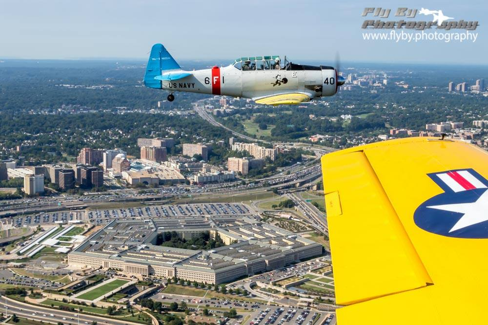 Texan Flight over Arlington National Cemetery with the Pentagon on our left, below. Photo by John Lackey of Fly By Photography