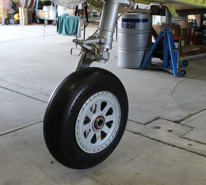 New wheels and tires are now installed on  the main gear legs. (photo via Tom Reilly)
