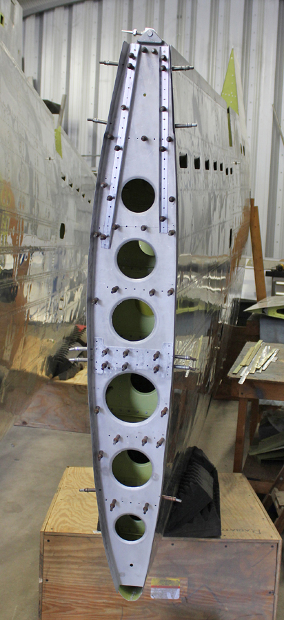 Finishing up the riveting on the final outboard wing bulkhead. The wing tip attaches at this station. (photo via Tom Reilly)