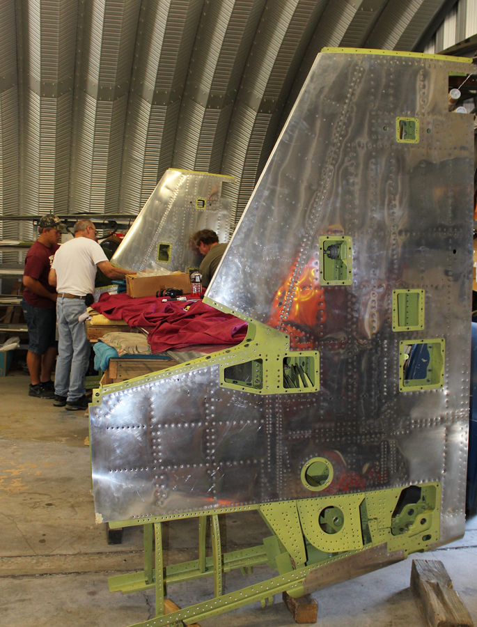 Attaching the vertical stabilizers to the horizontal stabilizer. (photo via Tom Reilly)