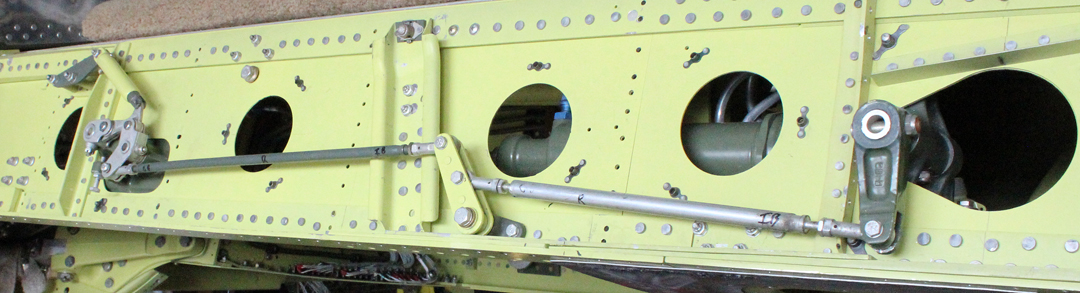 The center section main spar with the exposed gear up-lock mechanisms. (photo via Tom Reilly)