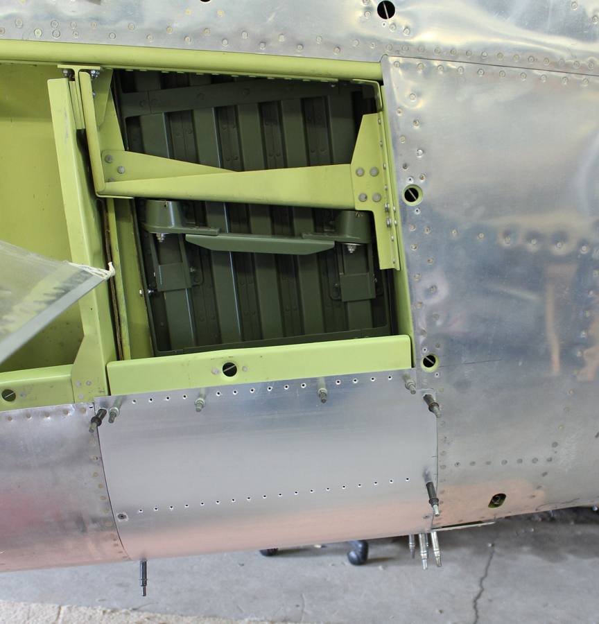 Fitting out one of the remaining close out panels on the radiator housing. (photo via Tom Reilly)