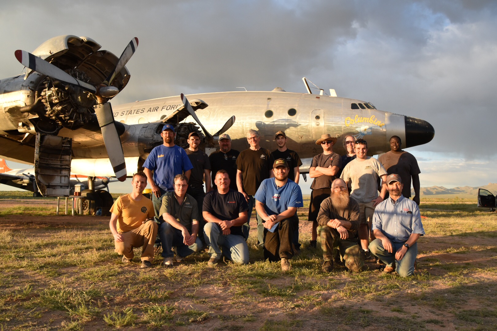 The crew from Dynamic Aviation and the Mid America Aviation Museum pose in front of Columbine II shortly after sunrise as they began work on the former presidential transport. (photo via Scott Glover)