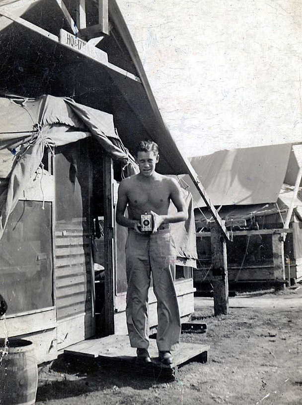 "The author's dad, Herb Gilmore, in front of a tent in ""Tent City"" at Hickam Field. (Photo via Author)"