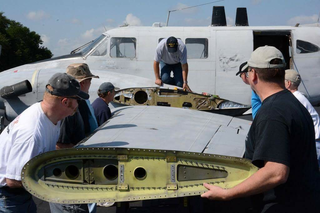 Reattaching the port outer wing panel. (Photo by Craig Landfield)