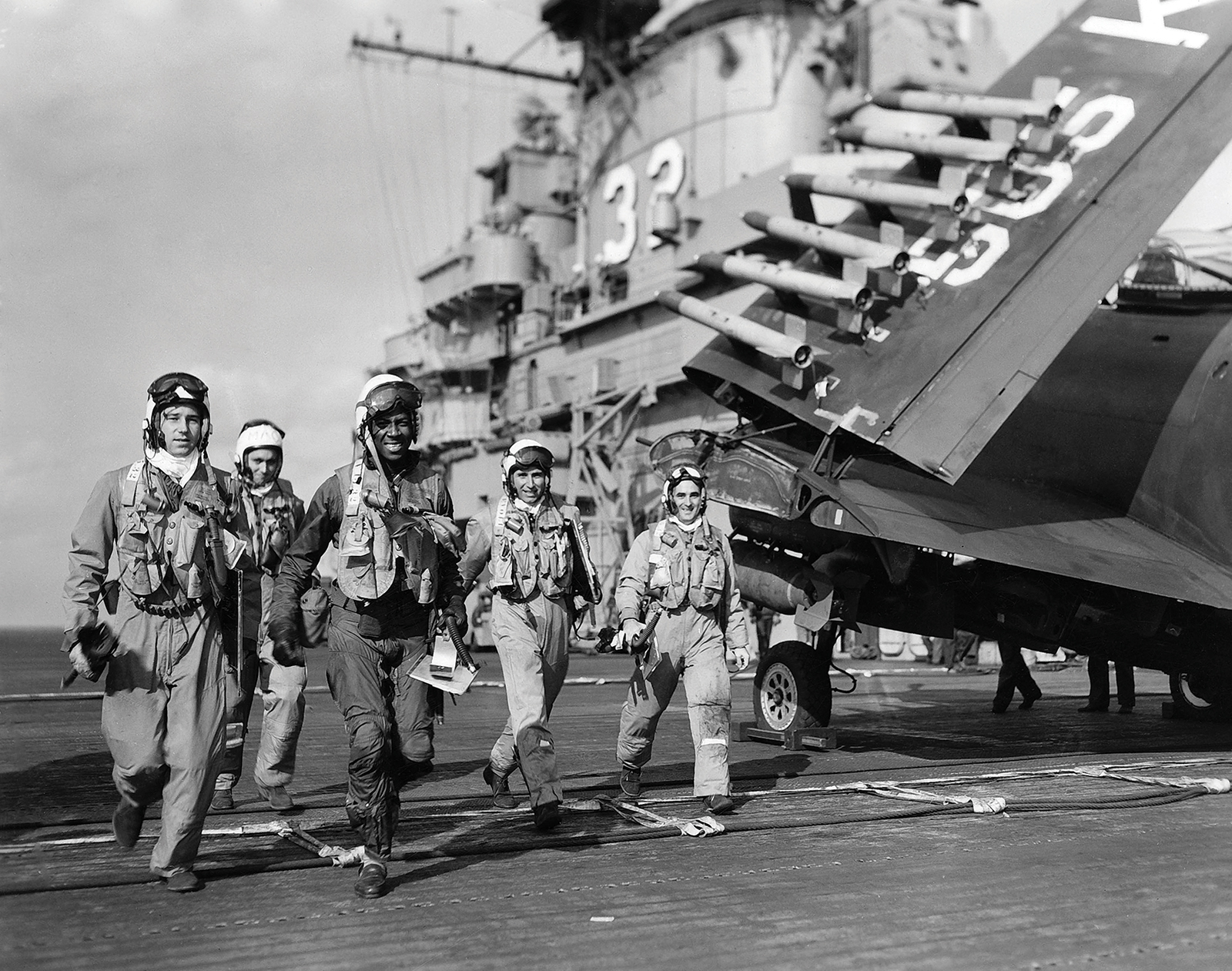 Ensign Jesse L. Brown, the first African-American naval aviator, walking with his cremates aboard the USS Leyte during the Korean War. (photo via Bryan Makos)