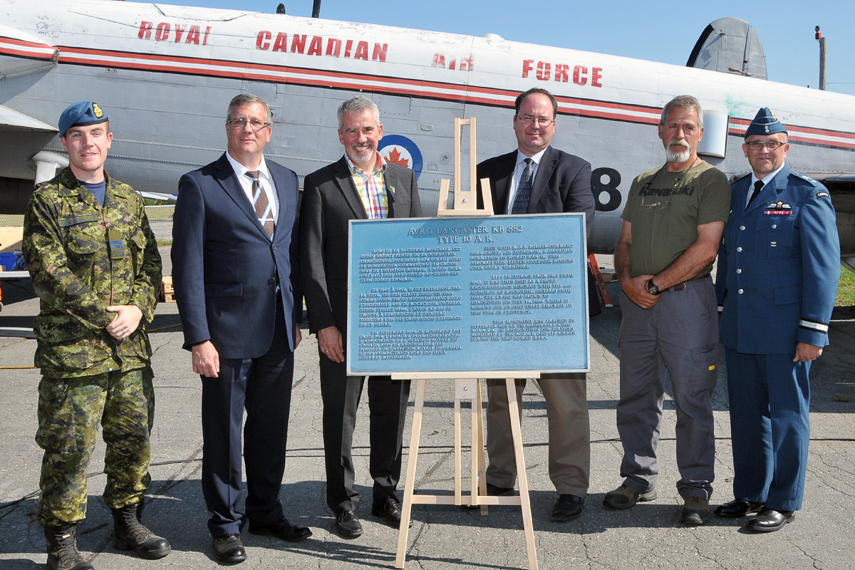 Gathered around the plaque presented by the Edmundston mayor to the National Air Force Museum are (from left) Captain Jamie Boudreau of ATESS, heading the team dismantling KB882; Kevin Windsor, museum curator; Mayor Cyrille Simard; Dr. Richard Mayne, the RCAF's chief historian; Mike Joly, head of the restoration shop at the museum; and Brigadier-General Scott Howden of the RCAF. (Photo by Warrant Officer Fran Gaudet DND)