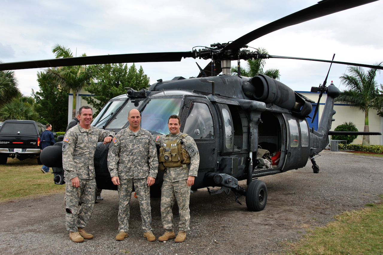 Pilots from the 160th Special Operations Aviation Regiment (Airborne) stand with the unit's last MH-60K Black Hawk, tail number 388, prior to handing the aircraft over to the National Navy Sea, Air and Land (SEAL) Museum Wednesday. The aircraft will be put on display to help museum visitors further understand the unique relationship between Army Special Operations Aviators and the Navy SEALs. (U.S. Army photo by Sgt. 1st Class Thaddius S. Dawkins II, United States Army Special Operations Aviation Command (Airborne) Public Affairs)