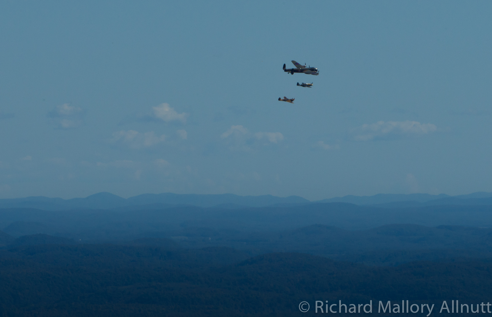 The Lancaster, Mustang and Kittyhawk over the Gatineau Hills. (photo by Richard Mallory Allnutt)