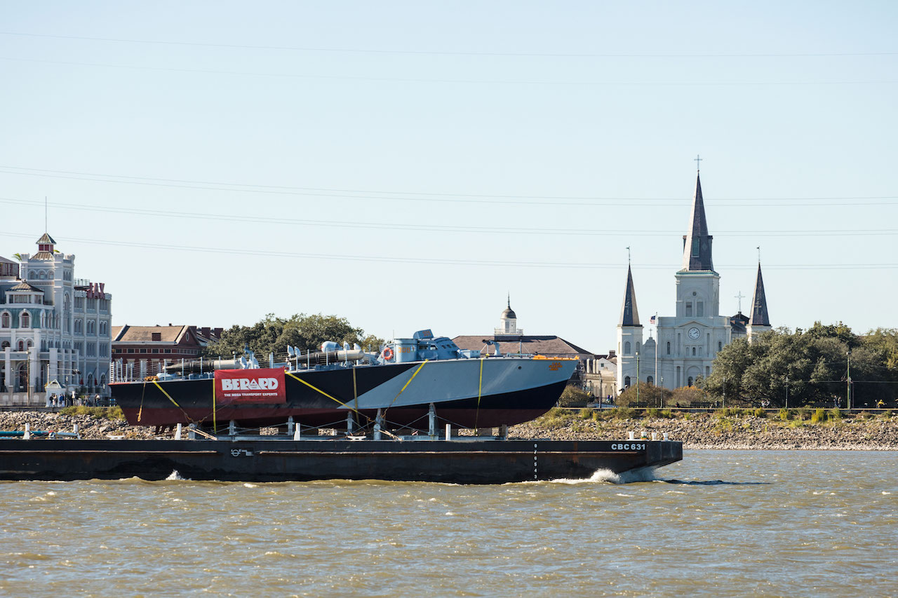 PT-305 is transported by barge on the Mississippi River to begin sea trails at Seabrook Marine & Harbor.