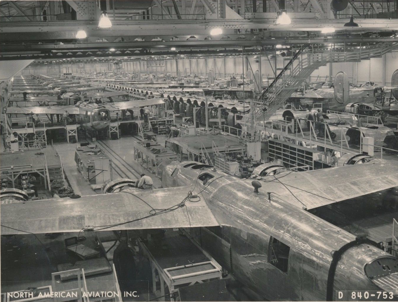 The Assembly lines at North American ran 24 hours a day, with workers divided into three 8-hour shifts, Liberators are seen here exiting the Western end of the facility at night.