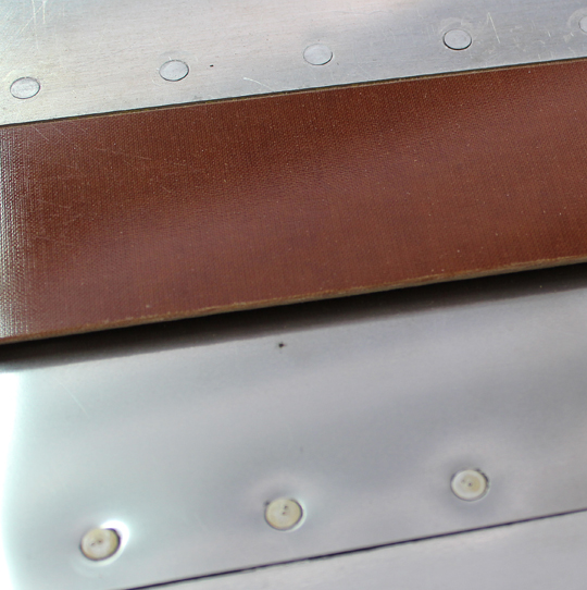 A close-up view of the phenolic rub strip. (photo via Tom Reilly)