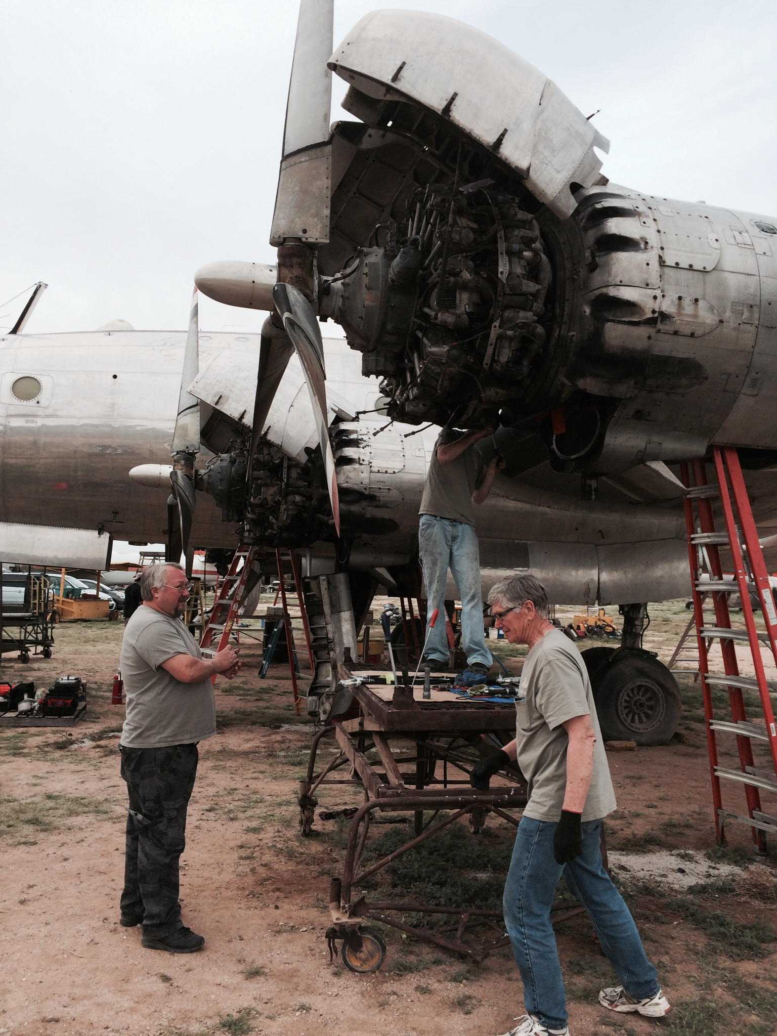 Tommy's crew working on the engines... (photo from Mid America Flight Museum)
