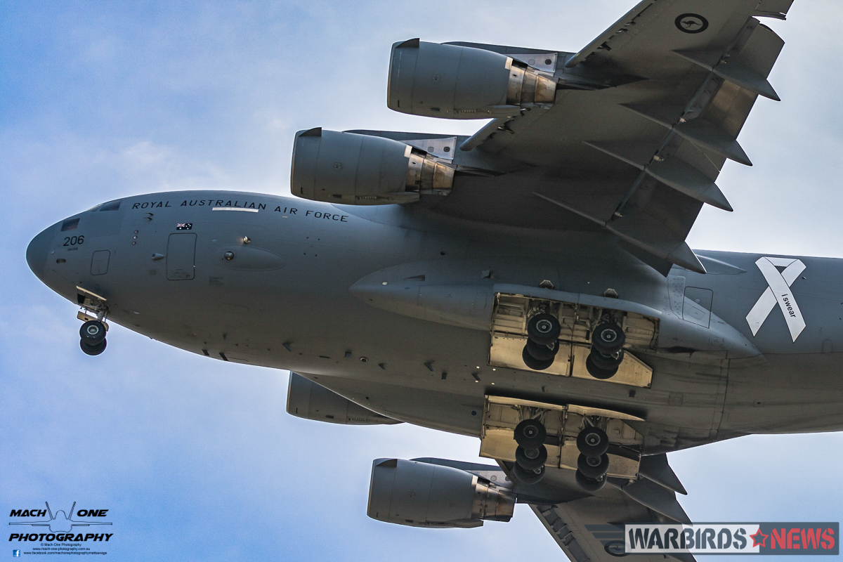 Aluminium Overcast – A RAAF C-17A Globemaster III flies a low, dirty pass down the Tyabb crowd line. This aircraft has been adorned with the White Ribbon, part of the Australian Defence Force's support of preventing violence against women. (photo by Matt Savage)