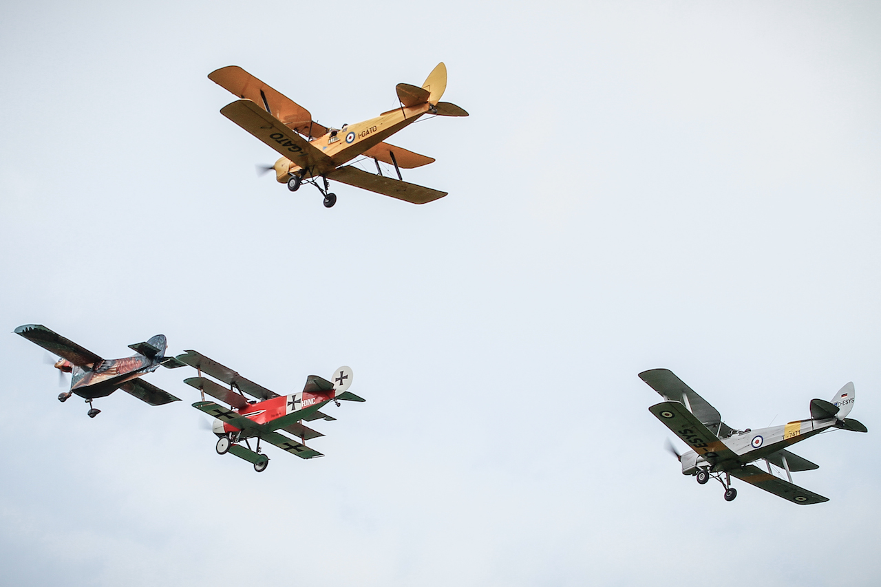 The world renowned AEROGALLO (Flying Rooster ) in formation with the Fokker and two Tiger moth.
