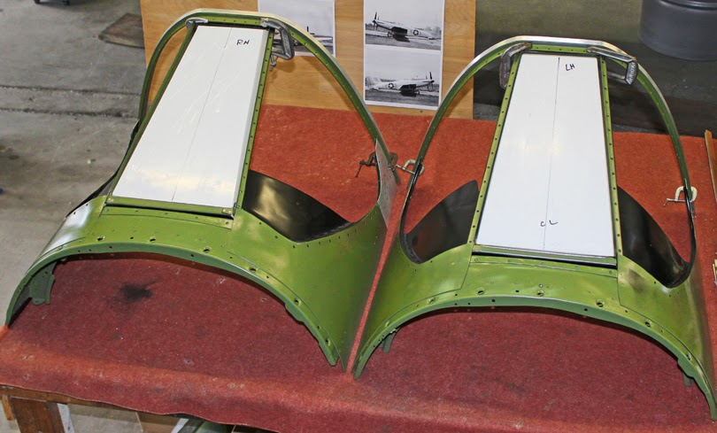 The two completed windshield assemblies and minus the glass side panels.