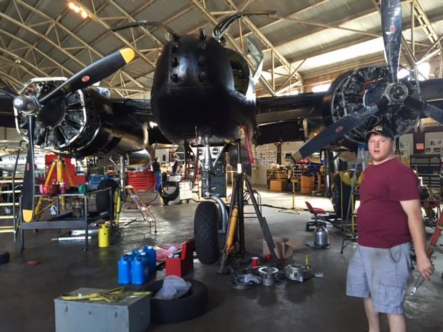 Working on the A-26 during winter maintenance. (photo via CAD A-26 Invader Squadron)