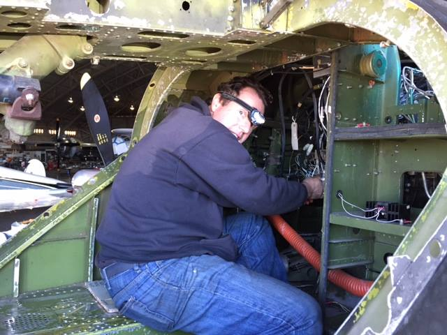 Working on the radios in the nose bay. (photo via CAD A-26 Invader Squadron)