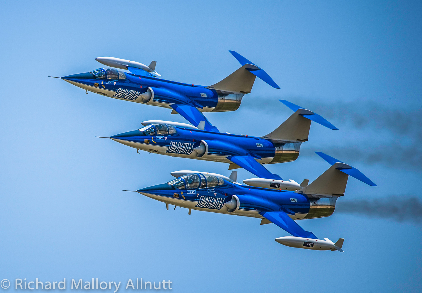 Three of the company's CF-104 Starfighters tucked into tight formation at Joint Base Andrews in Clinton, Maryland during the now biannual air show. (photo by Richard Mallory Allnutt)